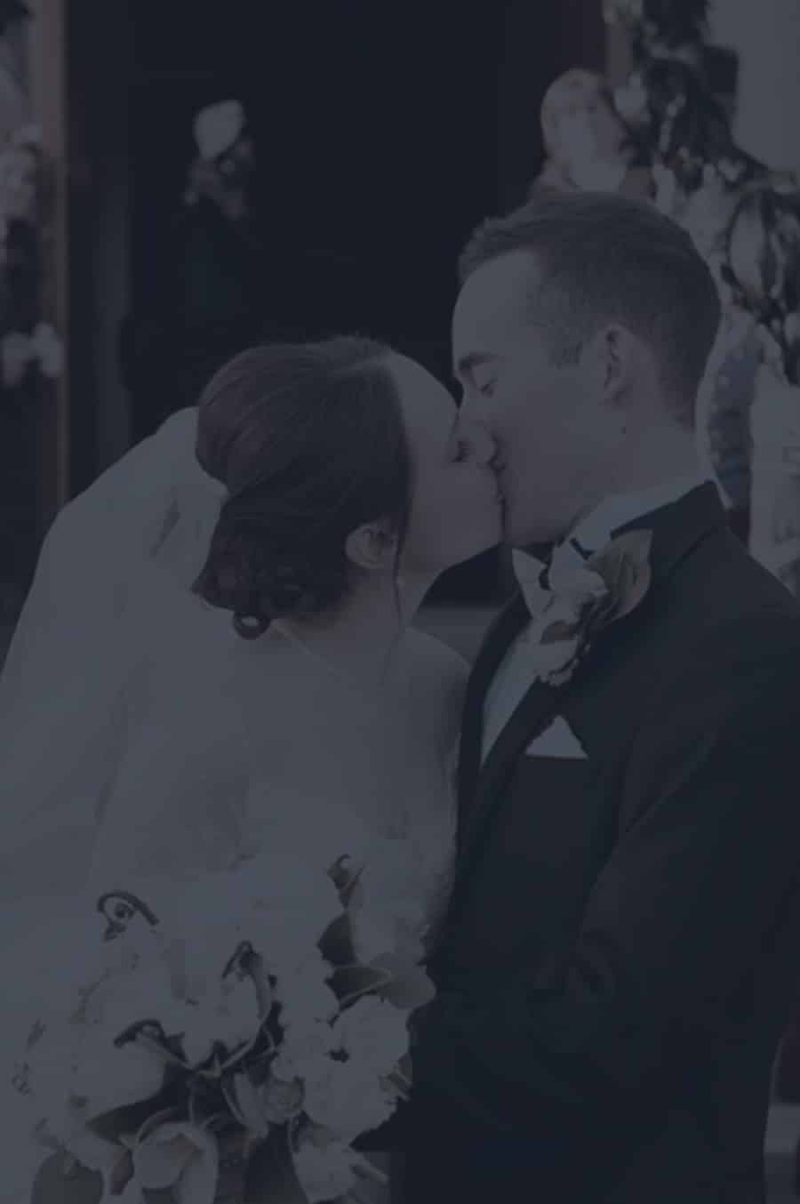 Couple kissing after the perfectly planned wedding by Pop the Bubbly in Charleston SC